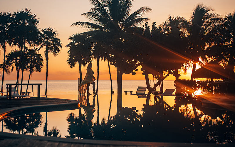 Belize beach resort - infinity pool at sunset
